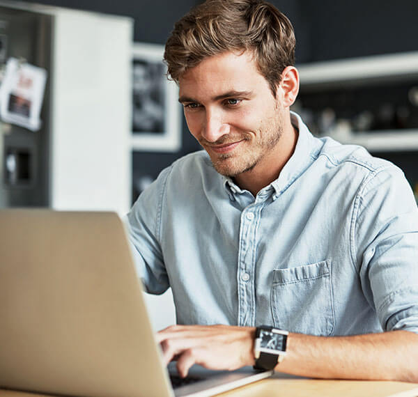 Man sitting at laptop