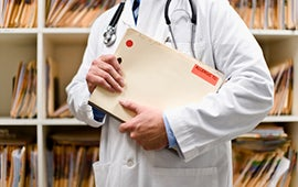 doctor holding file