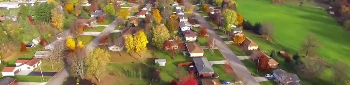 Home inspection index video with aerial view of houses